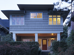 Image of the entry facade of the traditional home remodel and addition to a craftsman style home designed by residential architecture firm Donnally Architects in Seattle, Washington