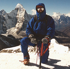 Image of Bruce Donnally on ImjaTse summit in Nepal at 20,300'.