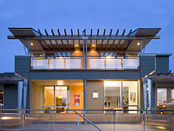 Image of front façade of the remodel of a house designed by residential architecture firm Donnally Architects in the Magnolia neighborhood of Seattle, Washington