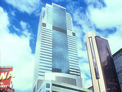Image of street level view of office tower in New York City.